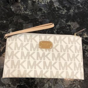 Michael Kors medium logo zip pouch.